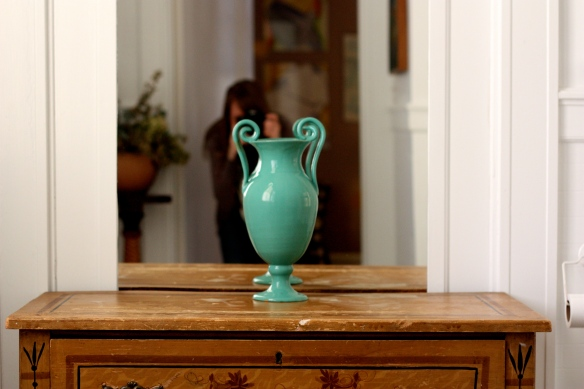 vase sitting on wooden chest