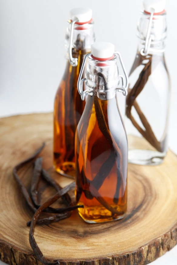 Vanilla beans and extract in jar