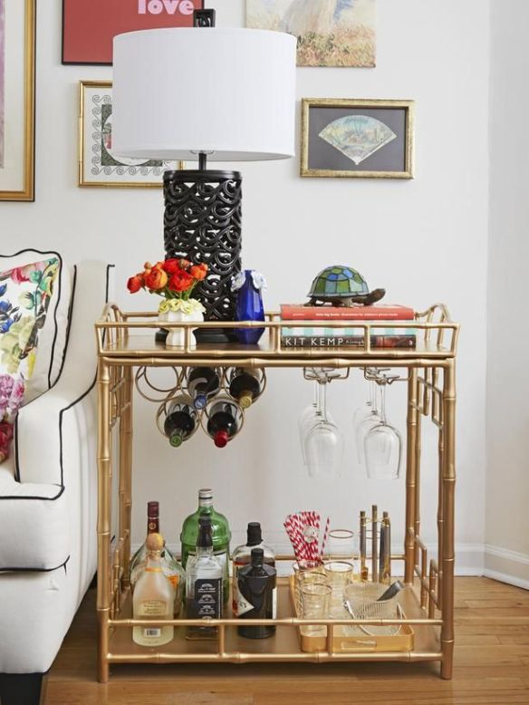 Bar cart used as side table next to couch