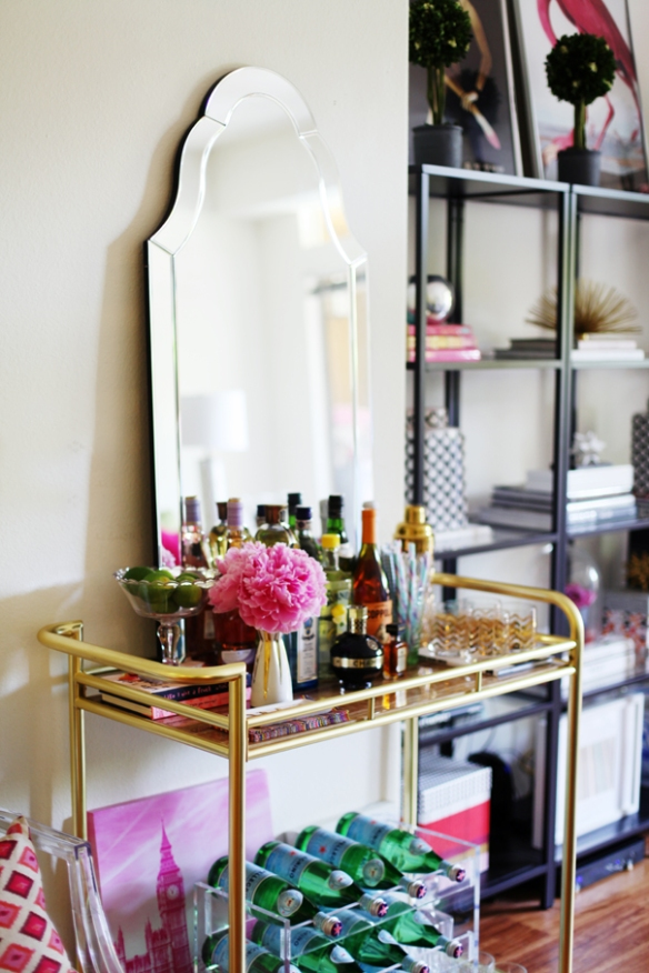 Bar cart with mirror leaning against wall